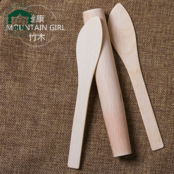 Mountain spoon scraping breadboard rolling pin