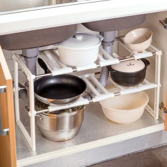 Stainless steel sink under the kitchen shelf rack